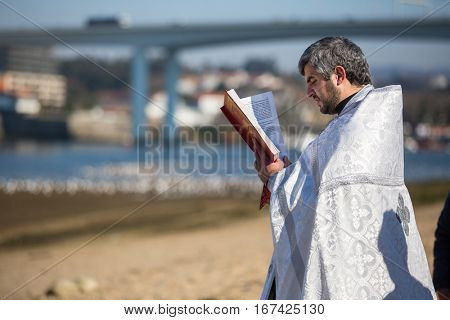 PORTO, PORTUGAL - JAN 19, 2017: Celebrating Baptism of Jesus in the Parish of Russian Orthodox Church near Douro river. This is one of the holiest holidays for all Christians.