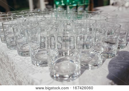 lot of empty glasses on a table outdoors