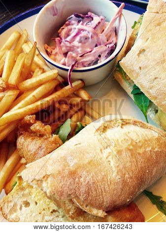 Gourmet battered chicken Ciabatta with french fries and coleslaw