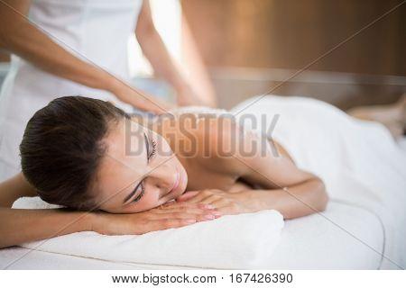 Close-up of woman receiving spa treatment from female masseur at spa