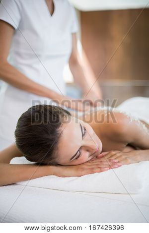 Close-up of woman receiving spa treatment from female masseur at health spa