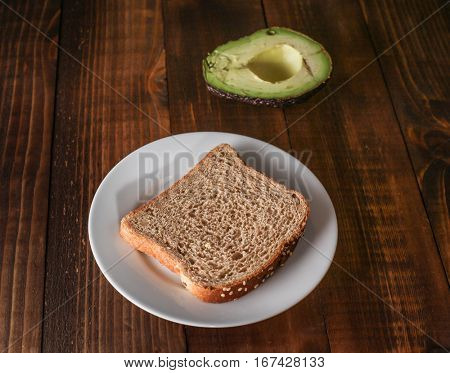 Table with avocado and bread