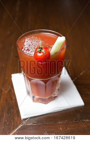 classic cocktail of vodka and tomato juice - Bloody Mary in a glass with celery and tomato
