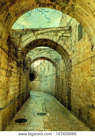 Ancient narrow street in old city of Jerusalem, Israel. Textured image for retro style