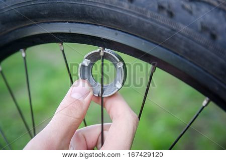 Mechanical adjusting the spokes of bicycle at nature