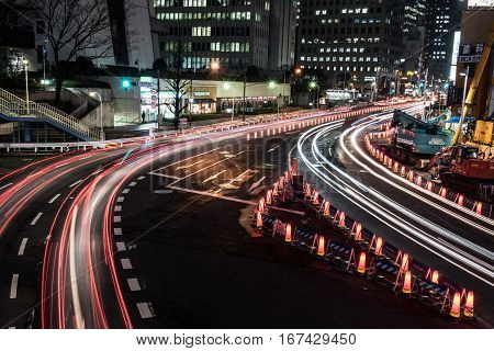 The bright and glowing nightlife of Japan is seen on the picture. Several highrise buildings and glowing streets are seen on the picture. Nights in Japan are simply amazing.
