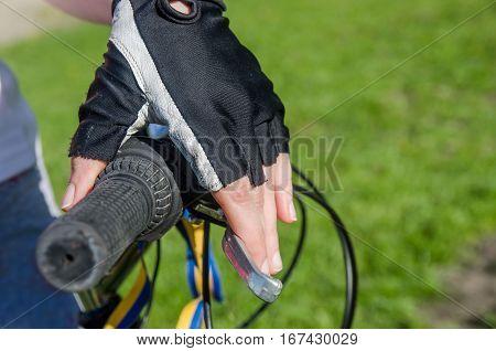 Hand holding bicycle handlebar - close up
