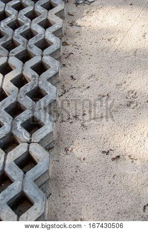 Installing paver bricks for the sidewalk pavement