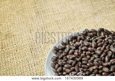 Cooked Black Beans On Linen Background.