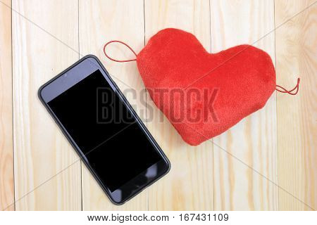 Smart Phone With Red Hearts On Wooden Background, Top View