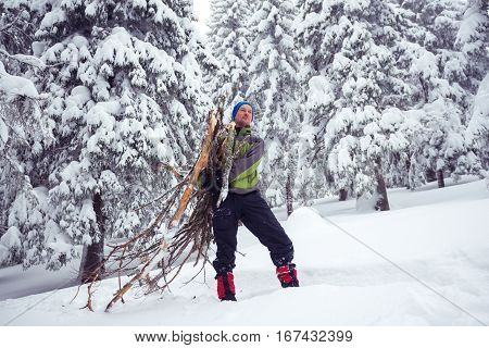 Dreaming Man Traveler Standing With An Armful Of Firewood