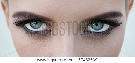 Close-up Face Of Pretty Girl With Beautiful Big Blue Eyes, Big Eyelashes And Eyebrows