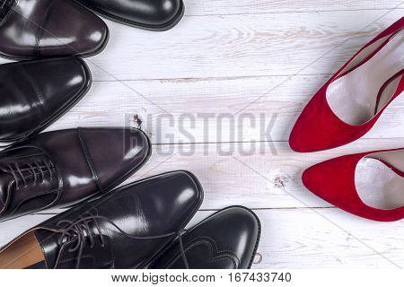 men's shoes and red high heel women's shoes on white background