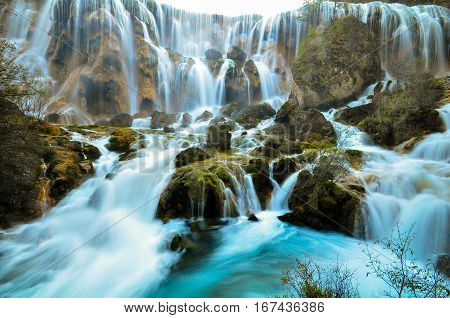 The Pearl Shoal Waterfall is famous waterfall in Jiuzhaigou, China. Waterfall in Juizhaigou known for multi-level structure and color. Jiuzhaigou in Sichuan, China. Jiuzhaigou is China national park.