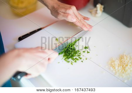 Chopping Fresh Parsley And Garlic