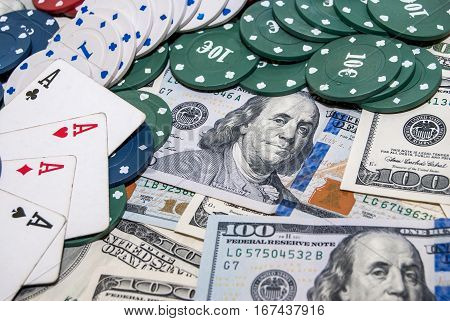 Poker Combination chips play cards and usa dollars bills in casino