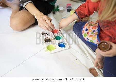 Woman And Child Hands Preparing Paintings