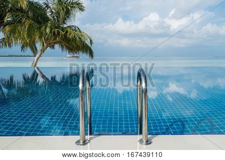 Pool by the beach in tropical resort