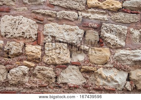 Stone wall rustic as texture close up