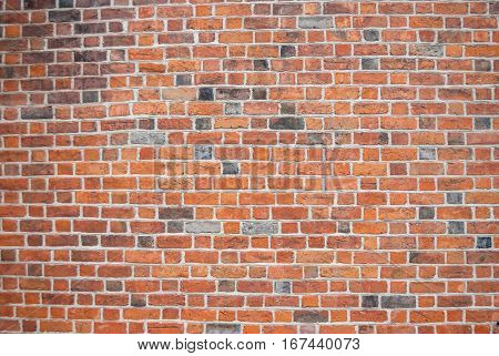 Background of red brick wall pattern texture close up