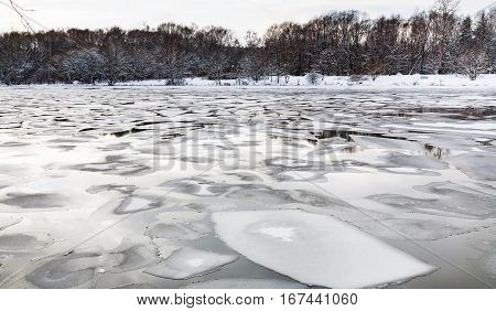 Floating Ice Floes On Surface Of River In Twilight