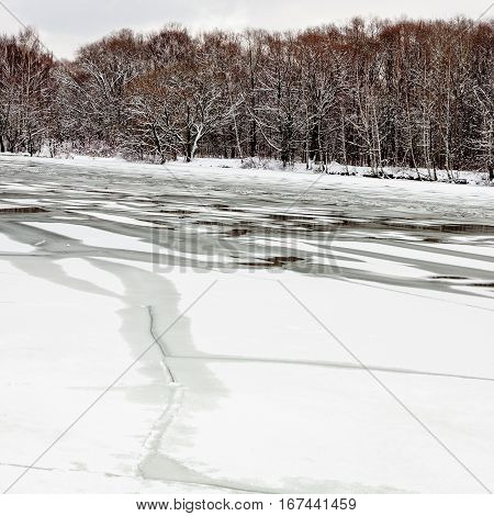 spring season - melting ice on frozen river