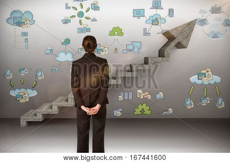 Businesswoman standing with hands behind back against digital composite image of gray steps moving up