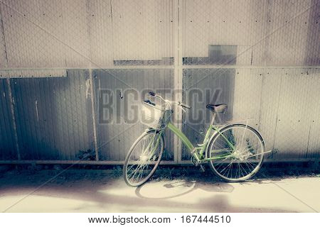 Bicycles parked by the wall - vintage and soft style