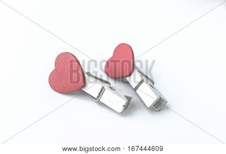wooden clothes pin or cloth pegs with heart shape design for valentine concept(vintage effect)