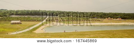 View on The Lake. Beach with vacationers. Summer panorama