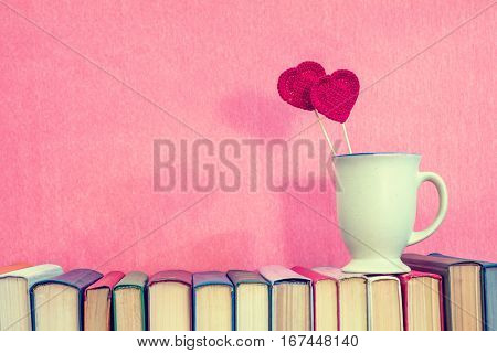 Cup With Red Crochet Hearts On Books