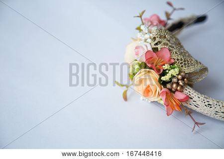 Beige headband with flowers. Beautiful accessory for head