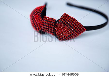 Hair hoop in red. Decorative accessory for head