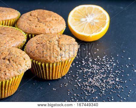 Muffins with chia seeds and lemon. Homemade muffins on black background