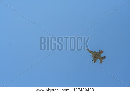 Fighter jet armed with missiles in the air