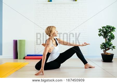Woman doing yoga exercise indoor. Lifestyle. traning concept