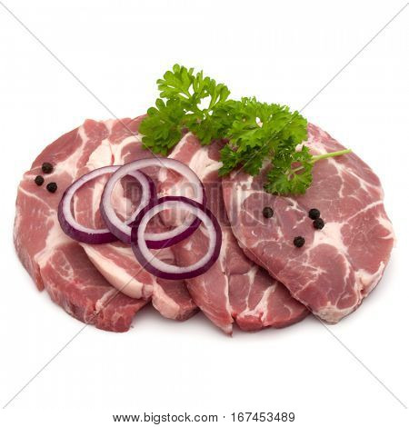Raw pork neck chop meat with parsley herb leaves, peppercorn spices and onion slices garnish isolated on white background cutout