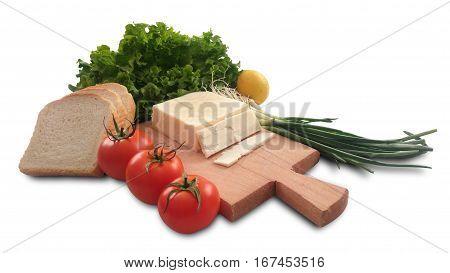 isolated tomato, lemon, lettuce, bread, fresh salad onion and cheese