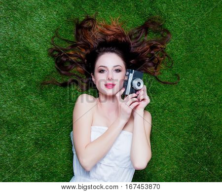 Portrait Of A Young Redhead Woman With Vintage Camera