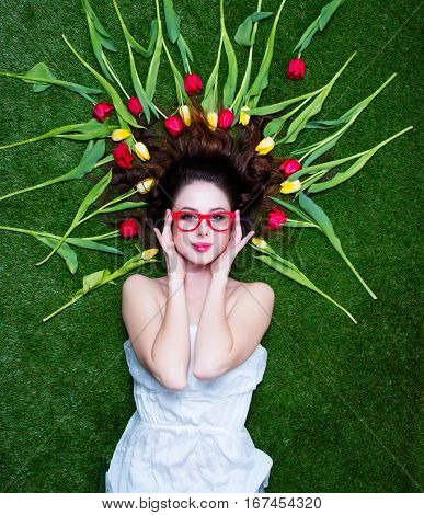 Portrait Of A Young Redhead Woman With Tulips And Glasses