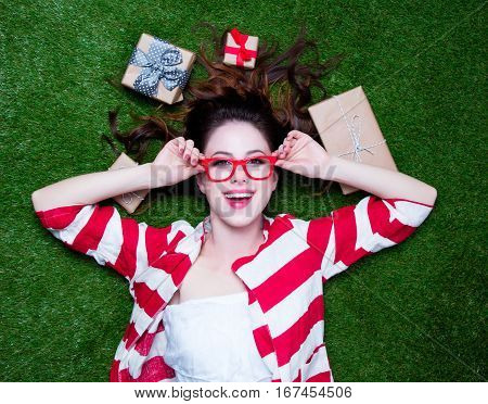 Portrait Of A Young Redhead Woman With Present Gifts