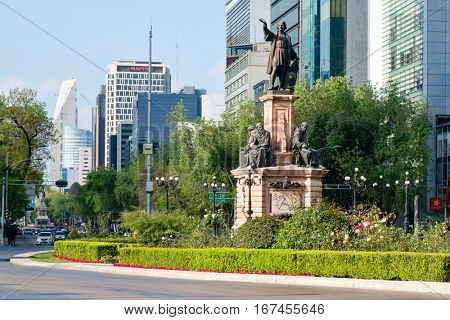 MEXICO CITY-DECEMBER 28,2016 : Street scene at Paseo de la Reforma in Mexico City near the Christopher Columbus statue