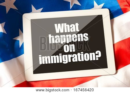 What's happens on immigration on tablet and USA flag