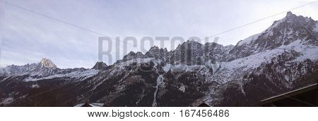 Alpine Views of a Village and the mont blanc mountain range in the french alps