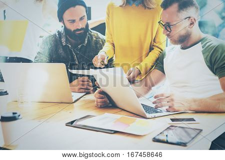 Concept of presentation new business project.Close up view adult businessman discussing ideas with account director and creative manager in modern office.Horizontal, blurred background