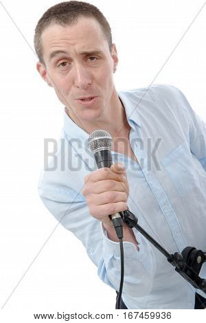 young handsome man singing with the microphone