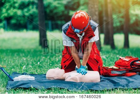 Cpr training outdoors, color image,  green background