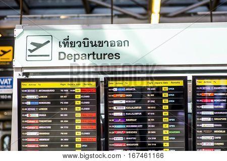 Bangkok Thailand - 29 November 2015: Departure board displaying flight numbers gates and times at Bangkok's main international airport