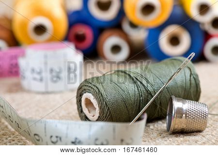 sewing kit with tape measure in the workroom
