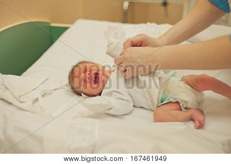 New born infant from cesarean section in operating theater. an extract of the newborn baby from the hospital